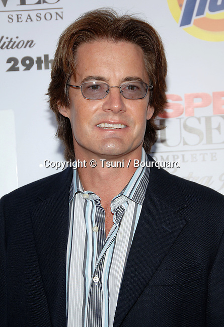 Kyle MacLachlan arriving at the DESPERATE HOUSEWIFES: Extra Juicy Edition, Season 2 DVD Launch Party on The Wisperia Lane set  In Los Angeles. August 5, 2006.<br /> <br /> eye contact<br /> headshot<br /> Glass