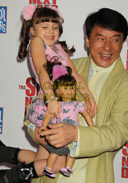 "ALINA FOLEY & JACKIE CHAN.""The Spy Next Door"" Los Angeles Premiere held at The Grove, Los Angeles, California, USA, .January 9th, 2010. .half length shirt jacket carrying pink dress suit green yellow .CAP/ADM/MJ.©Michael Jade/AdMedia/Capital Pictures."
