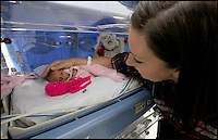 BNPS.co.uk (01202 558833)<br /> Pic: CorinMesser/BNPS<br /> <br /> Kat with Jasmine just after she was born with her crochet octopus.<br /> <br /> Twin baby girls who have beaten the odds to survive after being born three months premature have been reunited in time for Christmas.<br /> <br /> Little Jasmine and Amber Smith-Leach were born 12 weeks early, weighing just 2lb 2oz and 2lb 12oz respectively. <br /> <br /> Despite not being due until January 22, the babies have fought through setback after setback.<br /> <br /> Last night (sat) the pair shared a cot for the first time while mum Kat Smith slept next do them.