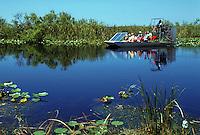 Tourist airboat ride through the River of Grass near the Tamiami Trail, Florida Everglades. Florida.