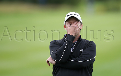 24.06.2012. Pulheim, Cologne, Germany. Australian golfer Marcus Fraser is disappointed after winning second place during the International Open golf tournament at Gut Laerchenhof in Pulheim, Germany, 24 June 2012.