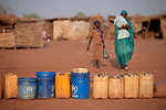 Jerry cans and buckets are placed in a line as people wait for the water pump to be turned on in the Yida refugee camp in South Sudan. Some 53,000 refugees from Sudan's Nuba Mountains live in the camp, with an equal number living in two nearby camps.