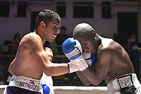 Rahmez Mahmood (purple shorts) defeats Edward Bjorkland during a Boxing Show at York Hall on 8th September 2018