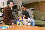Berkeley CA Adoptive parents entertaining daughter, Guatemalan, two-years-old with jumping jack toy (cause and effect) MR