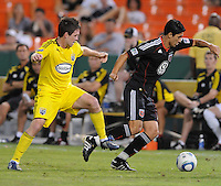 DC United forward Pablo Hernandez (21) fights for possession of the ball against Columbus Crew defender Danny O'Rourke (5)  The Columbus Crew defeated DC United 1-0 at RFK Stadium, Saturday September 4, 2010.