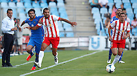 Getafe's Lafita (l) and Almeria's Ruben Suarez (l) and Rodri (r) during La Liga match.August 23,2013. (ALTERPHOTOS/Victor Blanco)