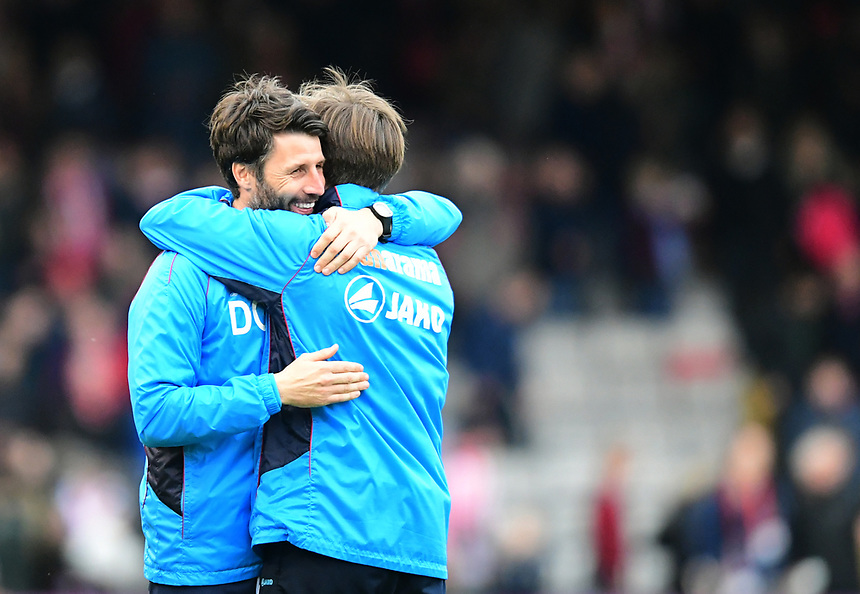 Lincoln City manager Danny Cowley, left, and Lincoln City's assistant manager Nicky Cowley celebrate the win at the end of the game<br /> <br /> Photographer Chris Vaughan/CameraSport<br /> <br /> Vanarama National League - Lincoln City v Torquay United - Friday 14th April 2016  - Sincil Bank - Lincoln<br /> <br /> World Copyright &copy; 2017 CameraSport. All rights reserved. 43 Linden Ave. Countesthorpe. Leicester. England. LE8 5PG - Tel: +44 (0) 116 277 4147 - admin@camerasport.com - www.camerasport.com