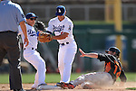 Giants' Mike Fontenot is out at second base against Dodger defenders Justin Sellers and Lance Zawadzki during a Cactus League preseason game between the Giants and the Dodgers in Glendale, Ariz., on Tuesday, March 6, 2012.  .Photo by Cathleen Allison