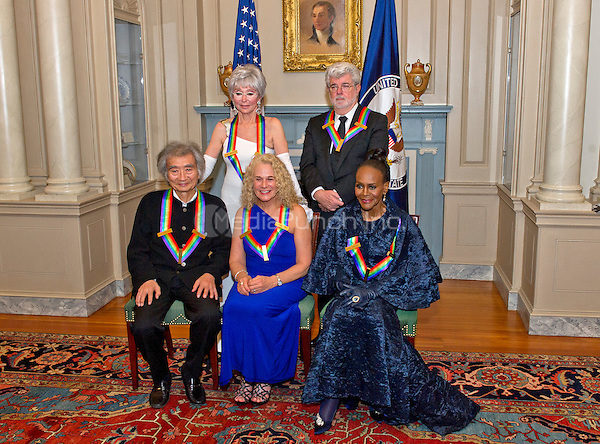 The five recipients of the 38th Annual Kennedy Center Honors pose for a group photo following a dinner hosted by United States Secretary of State John F. Kerry in their honor at the U.S. Department of State in Washington, D.C. on Saturday, December 5, 2015.  The 2015 honorees are: singer-songwriter Carole King, filmmaker George Lucas, actress and singer Rita Moreno, conductor Seiji Ozawa, and actress and Broadway star Cicely Tyson.  From left to right top: Rita Moreno and George Lucas. From left to right bottom: Seiji Ozawa, Carole King, and Cicely Tyson.<br /> Credit: Ron Sachs / Pool via CNP/MediaPunch