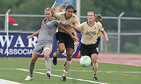 FC Gold Pride midfielder pulls down Philly defender Heather Mitts as she goes for the ball.  League leaders FC Gold Pride defeated the Philadelphia Independence, 3-1, in West Chester, PA.