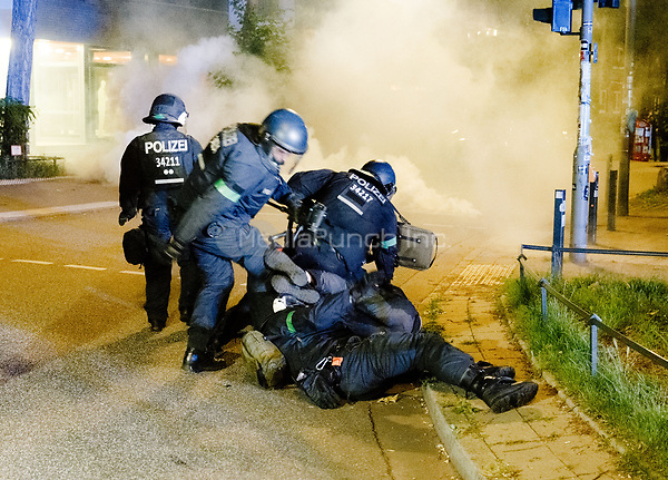 A group of police officers in riot gear arrest a protestor during demonstrations against the G20 summit in Hamburg, Germany, 6 July 2017. The summit, a meeting of the governments of the twenty largest world economies, begins on the 7 July and concludes on the 8 July. Photo: Markus Scholz/dpa /MediaPunch ***FOR USA ONLY***
