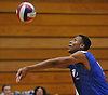 Stanley Elysee #15 of Port Washington sets up a return during a Nassau County varsity boys volleyball match against Bellmore JFK at Port Washington High School on Monday, Oct. 17, 2016. Port Washington won in straight sets; 25-23, 25-21, 25-15.