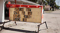 A sign advertising beef for sale outside a small family owned slaughter and meat packing company in Mead, Kansas. At this firm they typically slaughter ten animals each day but is one of only a few such sized companies in a region dominated by four giant meat packing plants that kill an process between five and six thousand cattle a day.