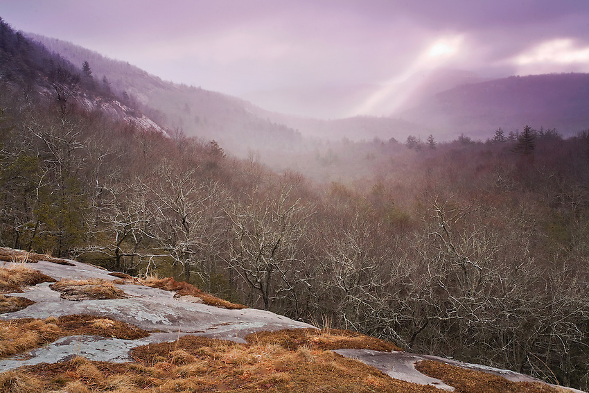 """PANTHERTOWN STORM"" -- Sunrise breaks through the clouds during a late winter snowstorm in the Panthertown Valley of western North Carolina."