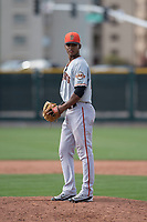 San Francisco Giants relief pitcher Camilo Doval (15) prepares to deliver a pitch to the plate during a Minor League Spring Training game against the Cleveland Indians at the San Francisco Giants Training Complex on March 14, 2018 in Scottsdale, Arizona. (Zachary Lucy/Four Seam Images)