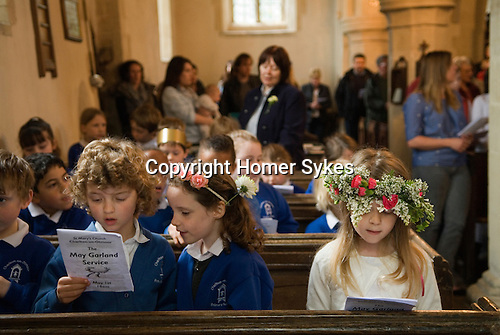 Charlton-on-Otmoor Oxfordshire May Day Celebrations. Children from the Church of England St Mary the Virgin Primary School process to the village church to have their May garlands blessed. The garlands are then hung on the church Rood Screen. The May Garland Service