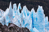 Blue glacier seracs at the terminus of the Meares Glacier in Prince William Sound, Alaska.