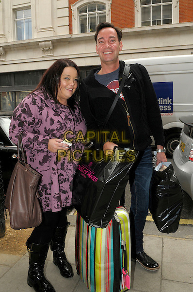 Lisa Riley & Craig Revel Horwood.arriving at BBC Radio 2 London, England..15th April 2013.full length black leggings pink purple jacket print bag purse brown boots house of fraser top jeans denim luggage suitcase baggage shopping plastic carrier bags.CAP/IA.©Ian Allis/Capital Pictures.