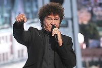 """Robert Charlebois performs at the """"Paris-Quebec"""" show of the 44th Festival d'ete de Quebec on the Plains of Abraham in Quebec city Thursday July 7, 2011."""