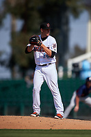 Inland Empire 66ers relief pitcher Aaron Cox (14) prepares to deliver a pitch during a California League game against the Lancaster JetHawks at San Manuel Stadium on May 20, 2018 in San Bernardino, California. Inland Empire defeated Lancaster 12-2. (Zachary Lucy/Four Seam Images)