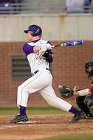 Zach Wright #20 of the East Carolina Pirates follows through on his swing versus the Elon Phoenix at Clark-LeClair Stadium March 29, 2009 in Greenville, North Carolina. (Photo by Brian Westerholt / Four Seam Images)