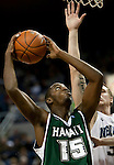 January 14, 2012:    Hawai'i Rainbow Warriors center Vander Joaquim is fouled as he shoots by Nevada Wolf Pack forward Kevin Panzer during their NCAA basketball game played at Lawlor Events Center on Saturday night in Reno, Nevada.