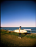 A surfer looks out at the surf in Mona Vale, Sydney, Australia.