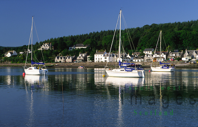 Yachts moored on the River Urr looking across to Kippford on the Solway Firth coast Scotland UK