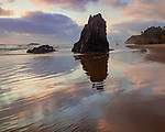 Ecola State Park, Oregon<br /> Sunset cloud reflections and silhouetted seastacks on Indian Beach