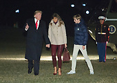 United States President Donald J. Trump, First Lady Melania Trump and their son Barron Trump return to The White House in Washington, DC, January 1, 2018 after their stay at Mar-a-Lago in Palm Beach, Florida.<br /> Credit: Chris Kleponis / Pool via CNP
