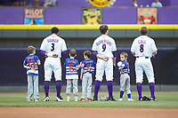 (L-R) Winston-Salem Dash outfielders Joel Booker (3), Blake Rutherford (9), and Alex Call (8) are joined on the field by youth baseball players for the National Anthem prior to the game against the Salem Red Sox at BB&T Ballpark on April 22, 2018 in Winston-Salem, North Carolina.  The Red Sox defeated the Dash 6-4 in 10 innings.  (Brian Westerholt/Four Seam Images)