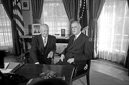 """United States President Dwight D. Eisenhower, left, meets President Charles de Gaulle of France in the Oval Office of the White House in Washington, DC on April 25, 1960.<br /> Credit: Benjamin E. """"Gene"""" Forte / CNP"""