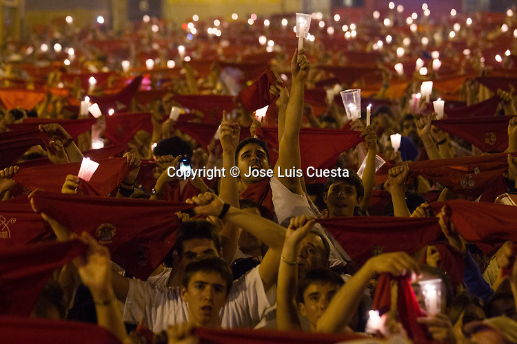 """People during the """"Pobre de mi"""" traditional song on the last day of Sanfermines and means the end of the festival in city hall square, Pamplona, northern of Spain. San Fermin festival is worldwide known because the daily running bulls."""