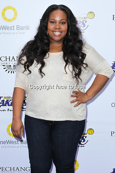 Amber Riley  at Lakers Casino Night Fundraiser Benefiting The Lakers Youth Foundation held at Club Nokia on March 10, 2013 in Los Angeles, California...Credit: MediaPunch/face to face..- Germany, Austria, Switzerland, Eastern Europe, Australia, UK, USA, Taiwan, Singapore, China, Malaysia and Thailand rights only -