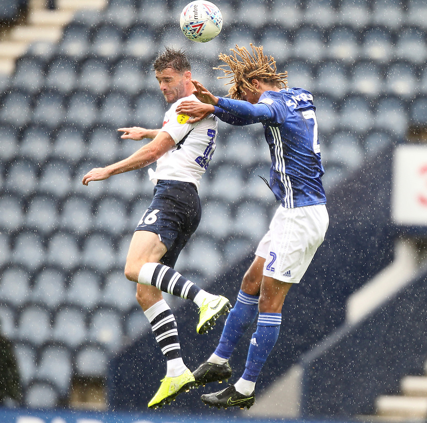 Preston North End's Andrew Hughes  jumps with Cardiff City's Don Sanderson<br /> <br /> Photographer Mick Walker/CameraSport<br /> <br /> The EFL Sky Bet Championship - Preston North End v Cardiff  City - Saturday 27th June 2020 - Deepdale Stadium - Preston<br /> <br /> World Copyright © 2020 CameraSport. All rights reserved. 43 Linden Ave. Countesthorpe. Leicester. England. LE8 5PG - Tel: +44 (0) 116 277 4147 - admin@camerasport.com - www.camerasport.com