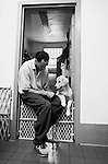 BEACON, NEW YORK:  Jesse, in prison for manslaughter in the first degree, plays with Gigi while sitting on puppy gate to his cell at Fishkill Correctional Facility.  Jesse says the program has taught him a sense of responsibility and compassion. The program works with prison inmates in New York, New Jersey, and Connecticut to train service dogs, including ones who help injured soldiers or those suffering from post-traumatic stress. The puppies live with the prisoners during a 18-20 month training process.