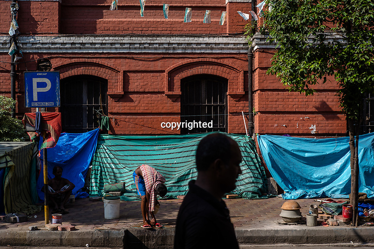 A man walks along a street next to the Indian Museum in the New Market area of Kolkata, India, on Saturday, May 27, 2017. Photographer: Sanjit Das