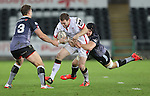 Ospreys flanker James King tackles Ulster centre Darren Cave.<br /> Guiness Pro12<br /> Ospreys v Ulster<br /> 20.12.14<br /> ©Steve Pope -SPORTINGWALES