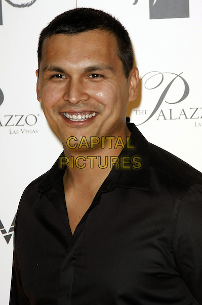 ADAM BEACH .New Year's Eve Celebrations at Lavo and TAO Nightclubs inside the Palazzo and Venetian Resort Hotel and Casino, Las Vegas, Nevada, USA, 31st December 2008..New Year's eve party  portrait headshot black shirt smiling .CAP/ADM/MJT.©MJT/Admedia/Capital Pictures