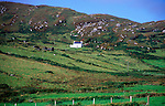 White isolated cottage on Dursey Head, Beara peninsula, County Cork, Ireland