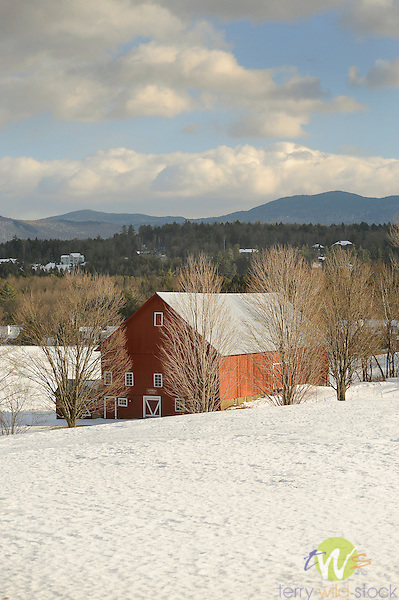 Red barn in winter with snow.