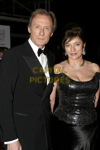 BILL NIGHY & GUEST.Leaving the After Party for the Pioneer British Academy Television Awards (TV BAFTA's), Grosvenor House Hotel, .London, April 17th 2005..half length.Ref: AH.www.capitalpictures.com.sales@capitalpictures.com.©Adam Houghton/Capital Pictures.