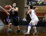 SIOUX FALLS, SD - MARCH 12:  Chandler White #10 from St. Francis looks for a teammate while being guarded by Talon Pinckney #11 from the College of Idaho during their semifinal game at the 2018 NAIA DII Men's Basketball Championship at the Sanford Pentagon in Sioux Falls. (Photo by Dave Eggen/Inertia)
