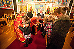 Christmas Eve Vigil Service at St. Sava Serbian Orthodox Church, Jackson, Calif. Sacrament at the end of the service