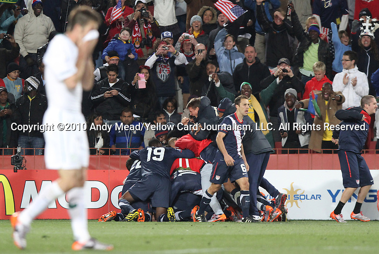 18 JUN 2010: U.S. players pile on Michael Bradley (USA) after his goal. The Slovenia National Team played the United States National Team to a 2-2 at Ellis Park Stadium in Johannesburg, South Africa in a 2010 FIFA World Cup Group C match.
