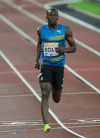 Usain BOLT of Jamaica (Men's 100m) crosses the line in 9.87 during the Sainsburys Anniversary Games at the Olympic Park, London, England on 24 July 2015. Photo by Andy Rowland.