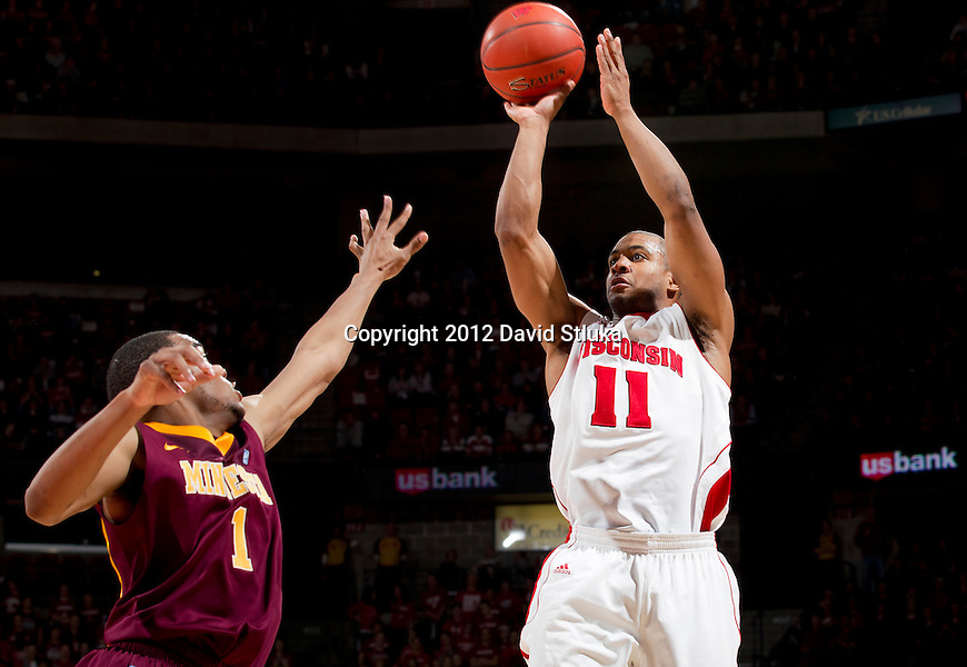 Wisconsin Badgers guard Jordan Taylor (11) shoots the ball during a Big Ten Conference NCAA college basketball game against the Minnesota Golden Gophers on Tuesday, February 28, 2012 in Madison, Wisconsin. The Badgers won 52-45. (Photo by David Stluka)