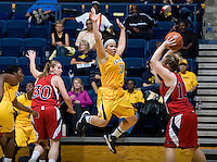 Mikayla Lyles of California tries to block Kate Gaze of St. Mary's during the game at Haas Pavilion in Berkeley, California on November 15th, 2012.  California defeated St. Mary's, 89-41.