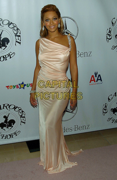 BEYONCE KNOWLES.16th Annual Carousel Of Hope Gala Presented By Mercedes-Benz held at Beverly Hills Hotel, Beverly Hills, California, USA, 23rd October 2004 ..full length pale pink peach dress silver strap .**UK SALES ONLY**.Ref:ADM.www.capitalpictures.com.sales@capitalpictures.com.©Capital Pictures.