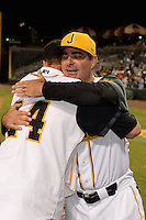 Jacksonville Suns first baseman Viosergy Rosa (44) hugs manager Andy Barkett (17) after being named MVP after game three of the Southern League Championship Series against the Chattanooga Lookouts on September 12, 2014 at Bragan Field in Jacksonville, Florida.  Jacksonville defeated Chattanooga 6-1 to sweep three games to none.  (Mike Janes/Four Seam Images)